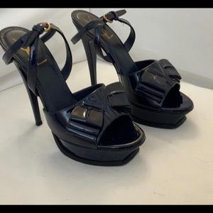 YSL NAVY PATENT TRIBUTE BOW SANDALS